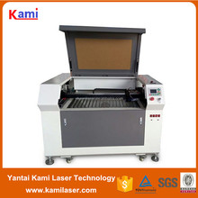 6090 low cost plastic laser cutting machines for jewelry have up and down platform