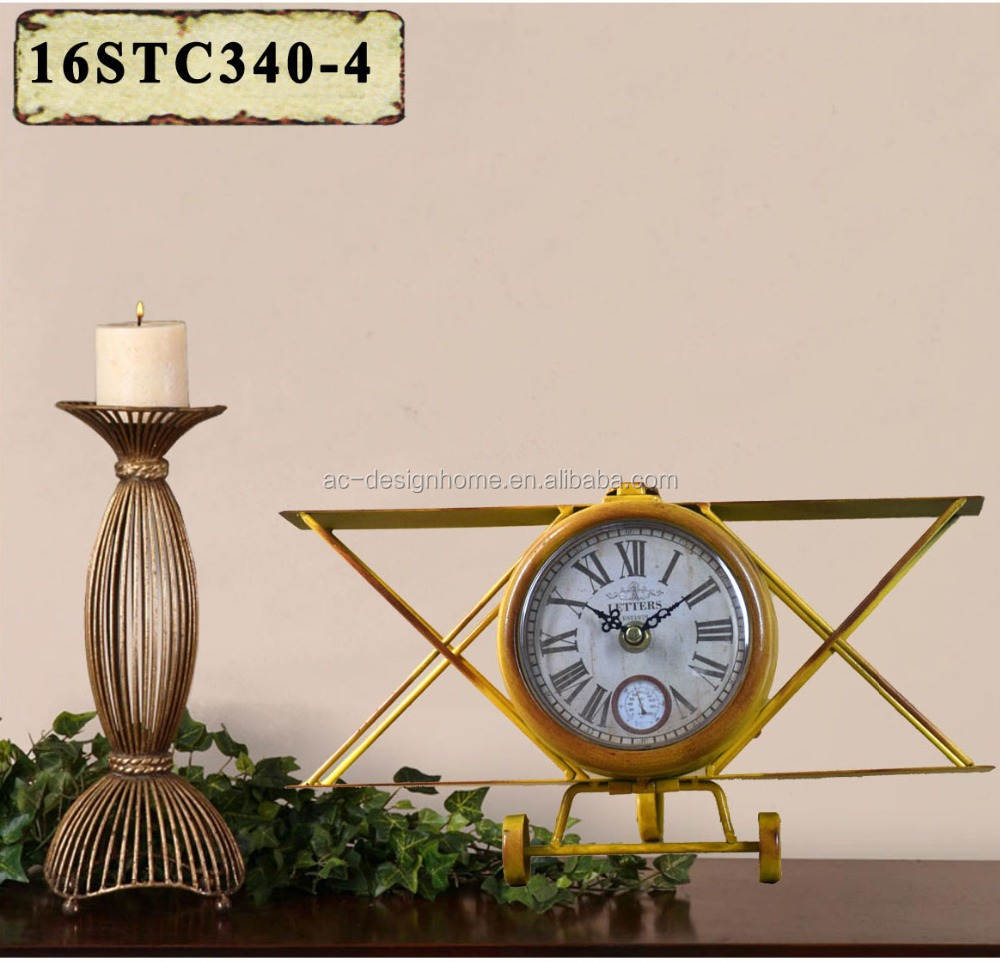 VINTAGE ANTIQUE DECORATIVE YELLOW METAL FLIGHT SHAPE TABLE TOP CLOCK