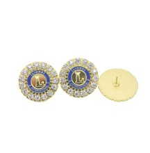 Gold plated metal and zircon stone inlay lions club badge