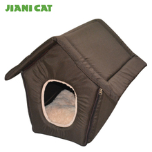 brown house shape indoor dog bed