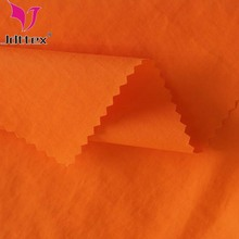 china supplier 320T woven ripstop 100% nylon taslan fabric