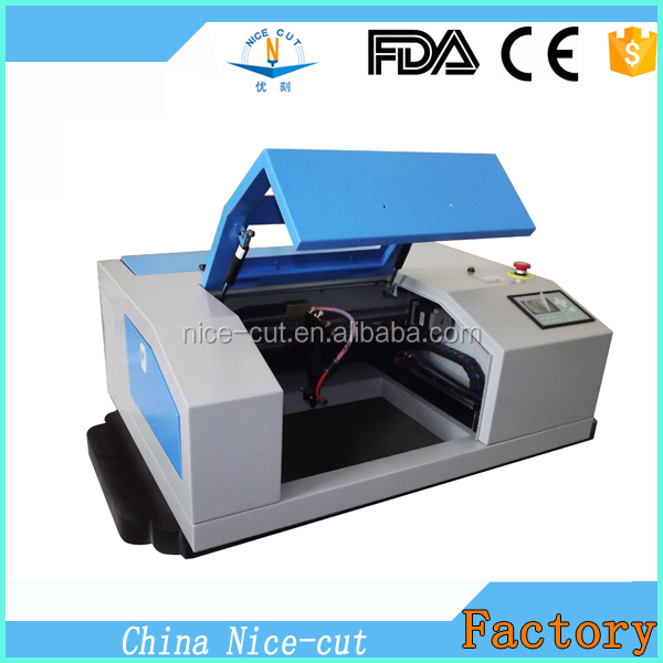 NC-5030 50w Mini Laser Engraving Machine/laser cutter for wood With Honey Platform with CE&FDA for price