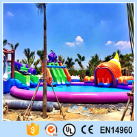 Inflatable round pool with giant slide/water park equipment