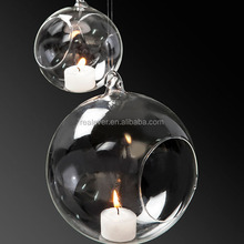 Hollow suspensible glass balls for tea light candles