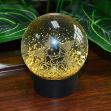 Customized Gold Foil Oil Filled Glass Snow Globe Manufacturer
