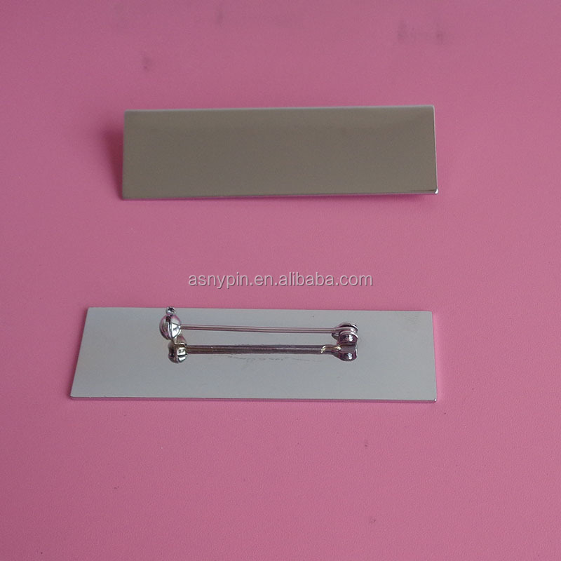 blank metal name tag with safety pin
