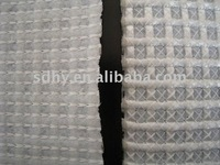 Reinforced stitched non-woven polyester fabric