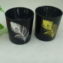 panited feather black candle holders