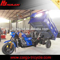 Heavy duty self dumping tricycle with hydraulic device