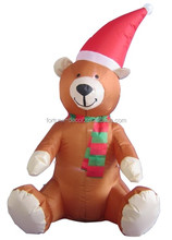 120cm high inflatable bear with scarf and hat is sitting on the ground