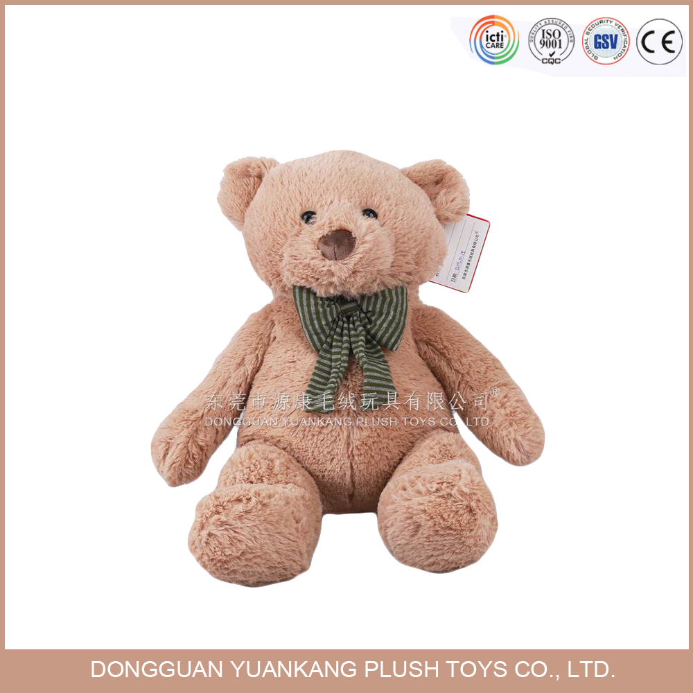 Plush light brown teddy bear with bowknot