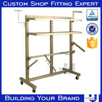 Tailor made movable metal garment display shelf with casters