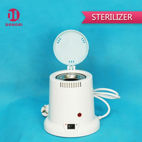 Nail bottle sterilizer and dryer