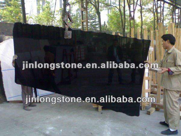 Natural mirror polished black granite with golden spot