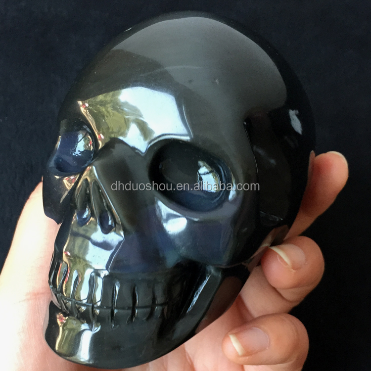 natural carved crystal black obsidian skull with blue color semi precious stone skull