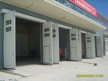 Industrial folding door Made in China with a small door| High quality industrial with windoor