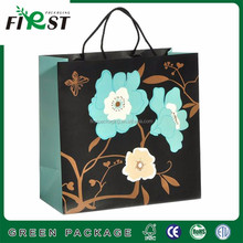 Fashionable large size gift paper bag with rope handle paper shopping gift bag customized