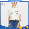 Wholesale women clothing wink eye print tee contrast neck drop shoulder t shirt graphic t shirt women