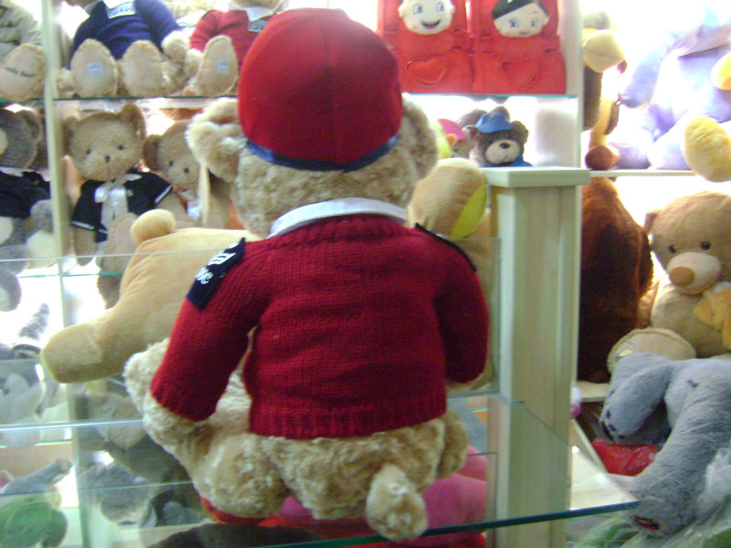 25cm customized soft stuffed police bobby bear toy with red uniform and cap