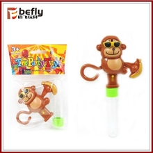 Plastic tube candy monkey toy with banana