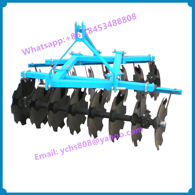 Tractor mounted offset disc harrow farm implement