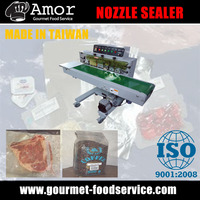 Automatic parallel nozzle type vacuum rotary sealer with powder coating