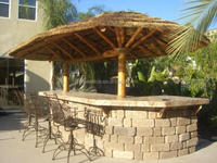 Oval Design With Africa Thatch Panels And synthetic Bamboo fence