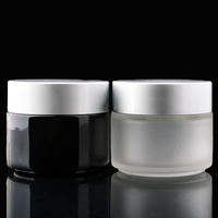 Custom Round Shape 100G Frosted Glass Cosmetic Cream Jar With Silver Cap