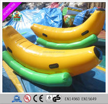 Factory price Cheap 0.9mm PVC amusement park equipment inflatable banana boat inflatable seesaw/ float for sale