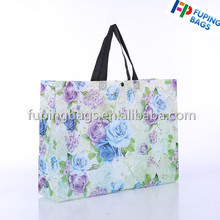 Full printed flower pattern non woevn die cut untrasonic folding garment shopping bag with button on top handle