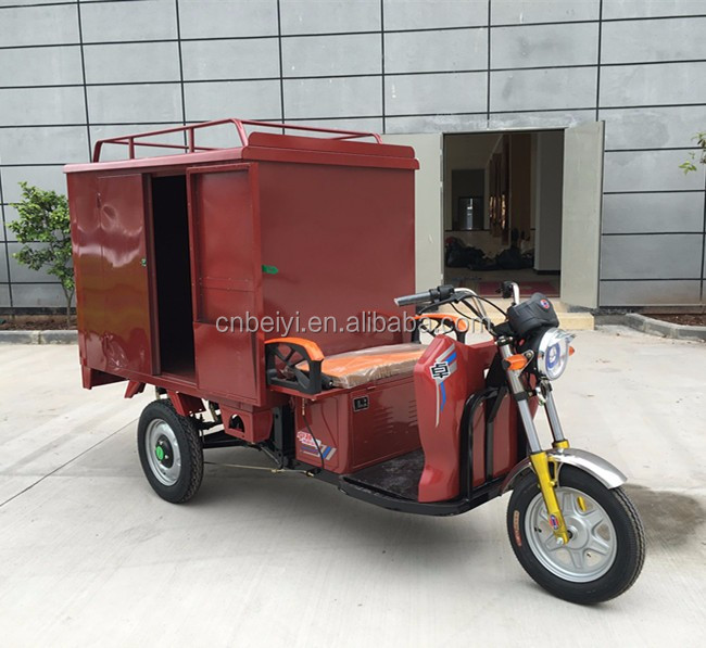 Chongqing Dayang heavy loading enclosed cabin adult electric tricycle for sale in South America