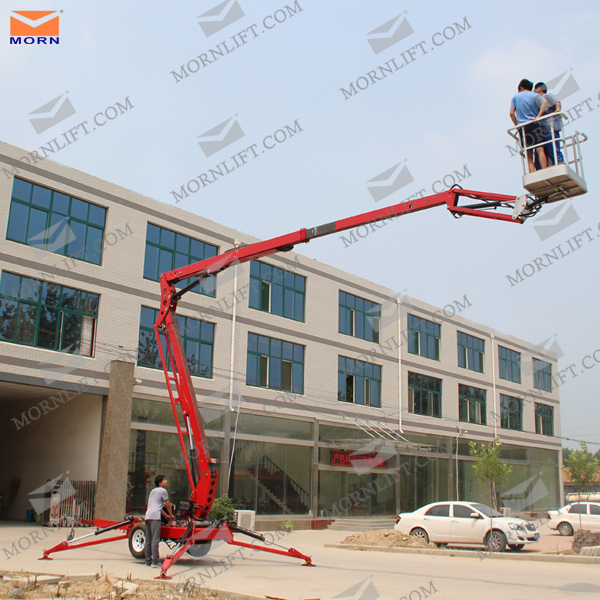 Towable hydraulic man boom lift