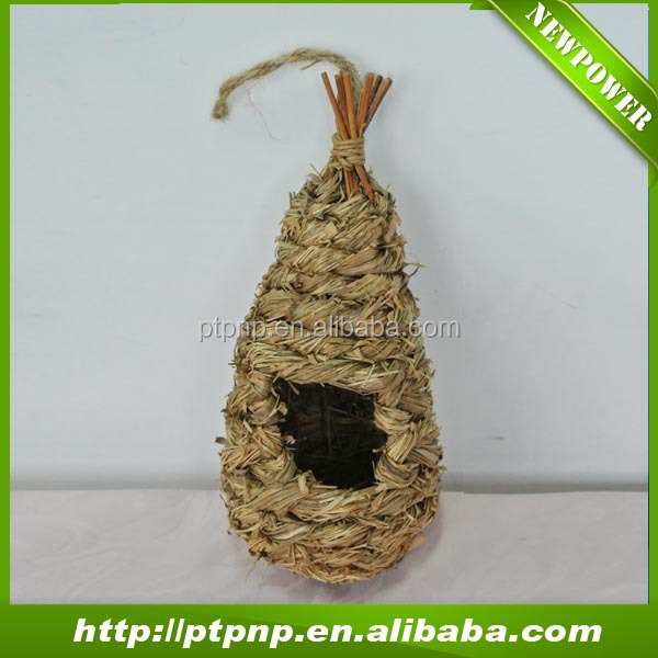 Hanging natural handmade eco-friendly wild bird house nest feeder made by plant leaves