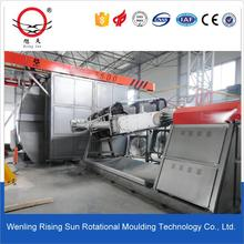 Shuttle rotomolding machine for making plastic water tanks
