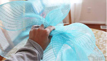 mesh gift wrap with big bow in birthday gift box