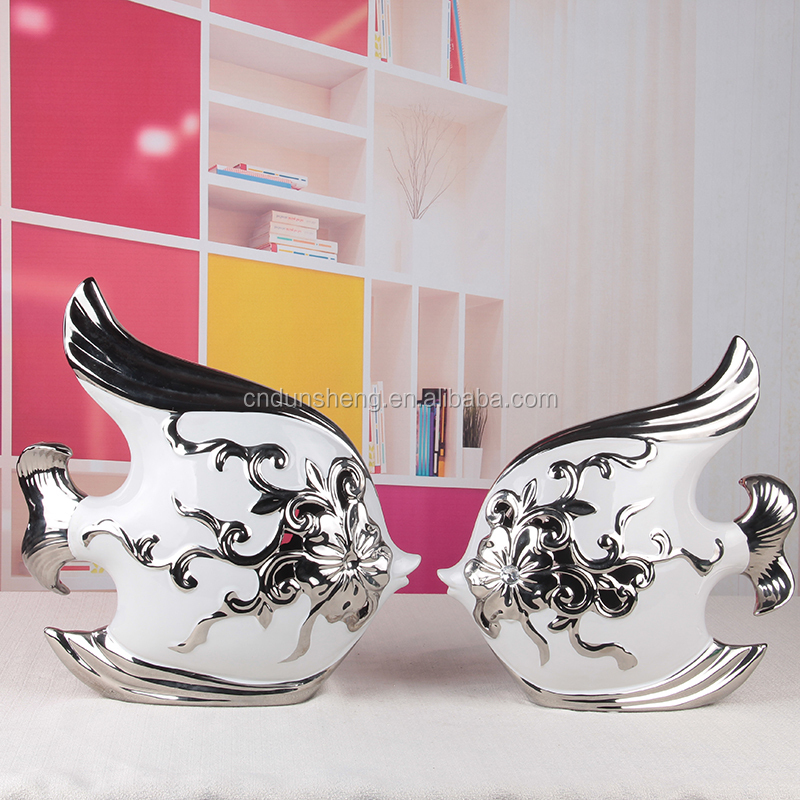 Chinese village style electroplated white and silver porcelain fish figurines