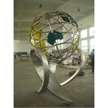 metal decorative stainless steel world globe supported by a art figure