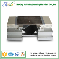 Modular metal expansion joint filler for marble floor