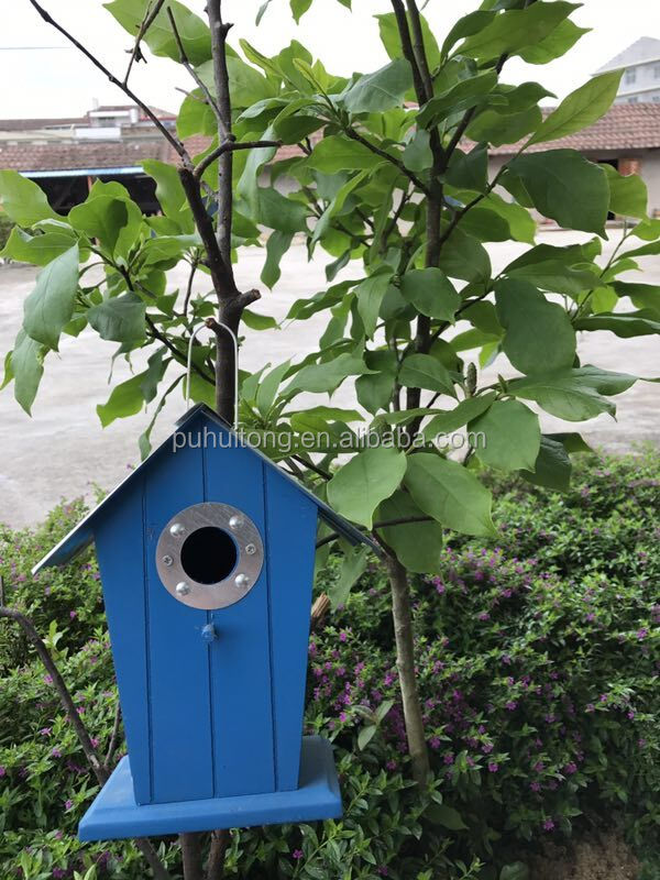 Wood bird house with metal roof