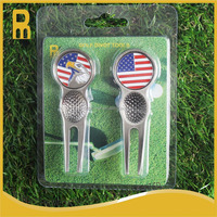 Golf divot repair tools or gof pitchforks with golf ball markers