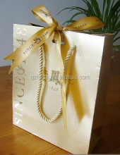 Custom luxury gold color hot stamp paper bag with hole for bow tie ribbon and twist handle