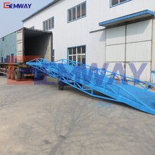 Hydraulic truck portable loading ramp for warehouse