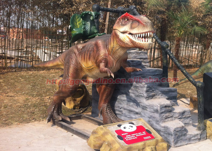 Amusement park most popular coin operated dilophosaurus ride