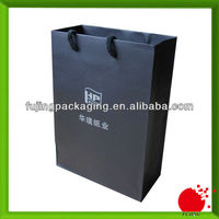 Black large packaging paper bag with UV logo