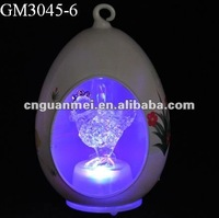 easter egg with LED light and chicken inside