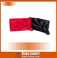 Pronmotional cosmetic bag made in red satin fabric with flower shape decoration