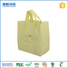 Light yellow handle plastic bag stand up shopping bag