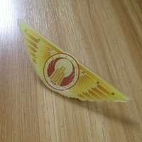 Wing shape yellow color led badge with butterfly clucth