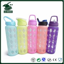 Clear borosilicate glass drinking bottle with assorted silicone sleeve