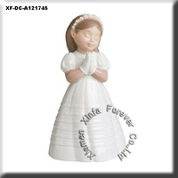 ceramic communion figurine